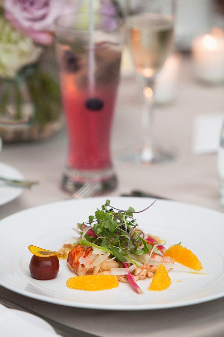 Lobster with lettuce and orange fillets as an appetiser for a wedding meal