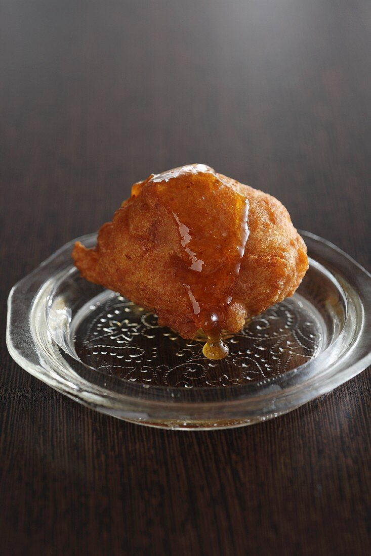 Oliebollen (deep fried pastry, Netherlands) with almonds and honey