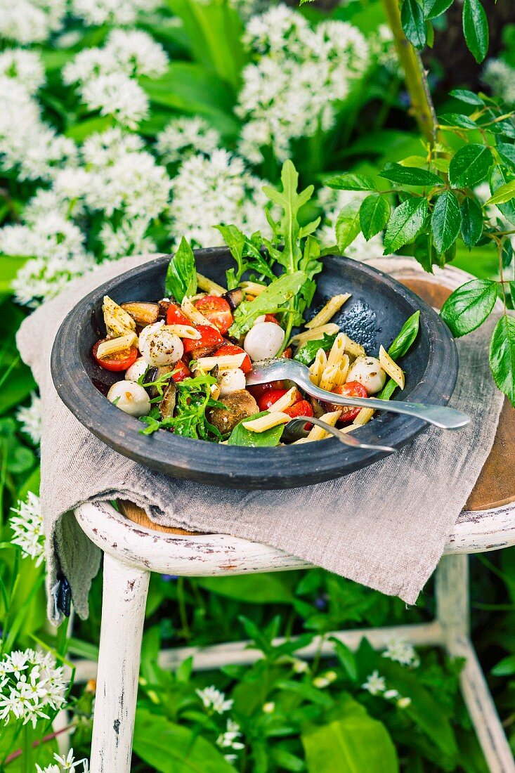 Pasta salad with roasted aubergines, tomatoes and mozzarella