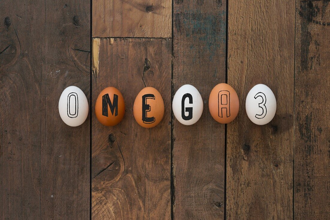 A row of eggs spelling the word 'Omega 3'