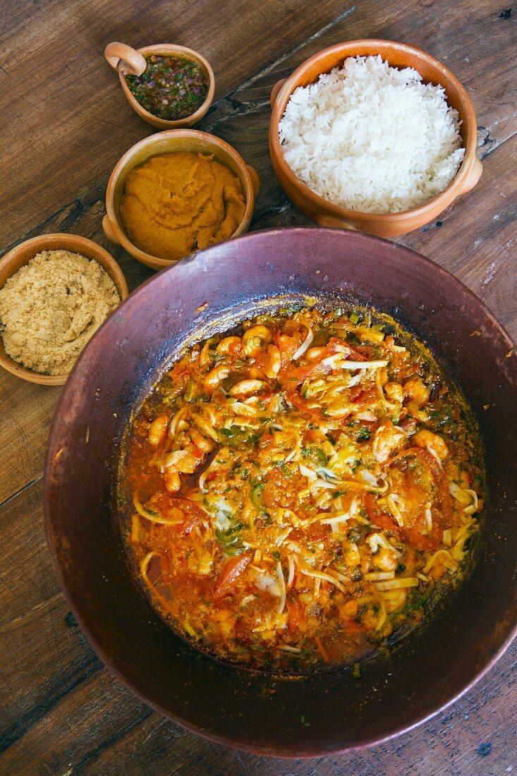 Seafood moqueca (traditional Bahian dish with vatapà, rice and manioc farofa, Brazil)
