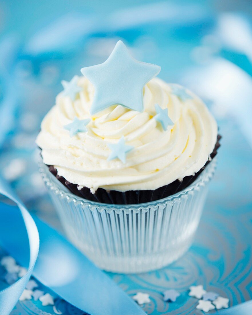 A white chocolate cupcake decorated with a fondant star