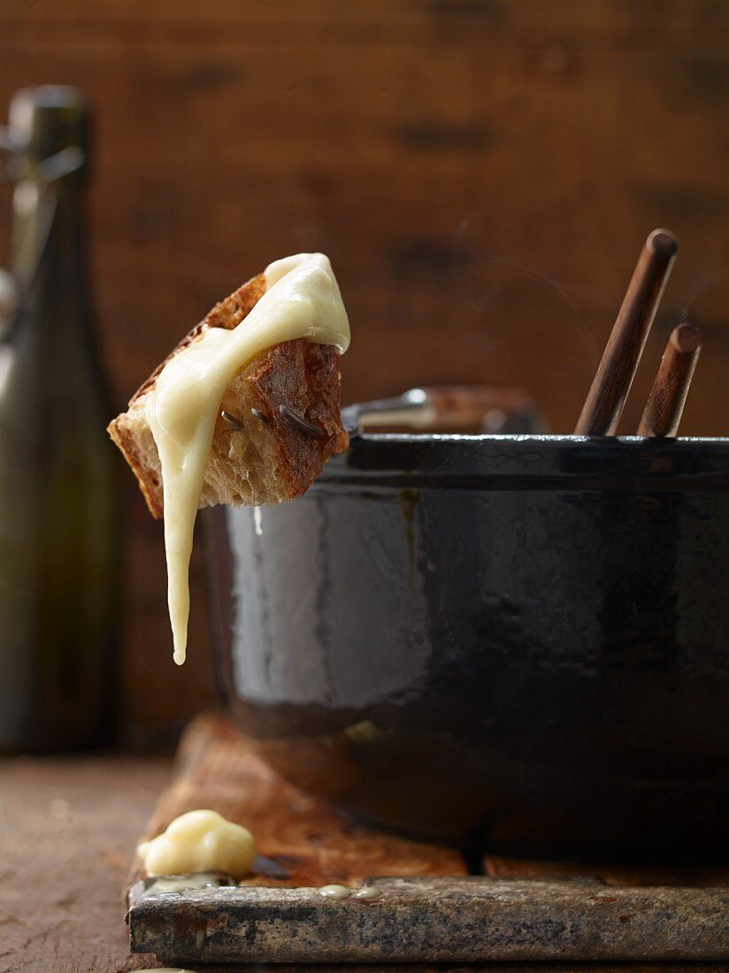 Cheese fondue with a piece of bread