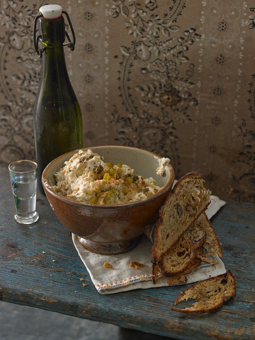 Liptauer cheese spread with rosemary bread chips