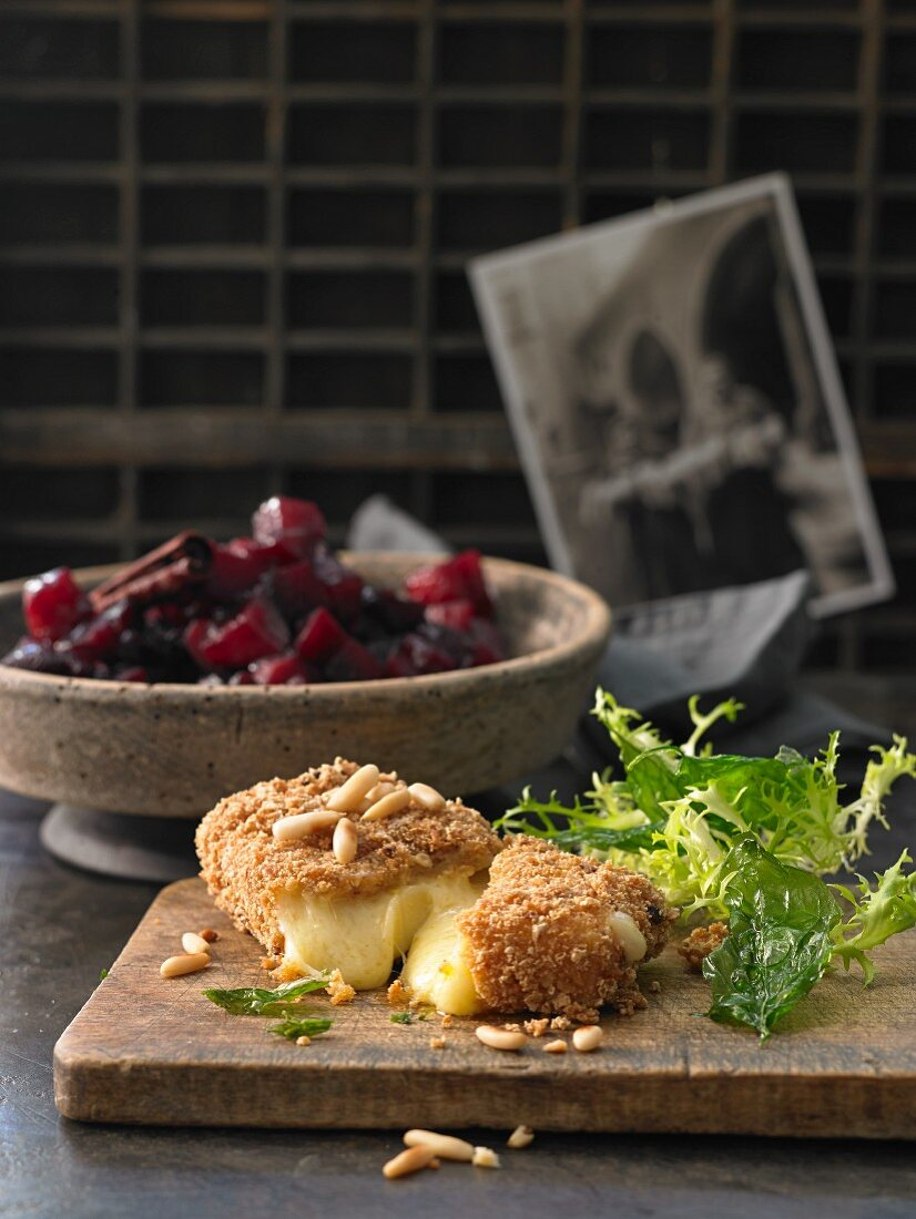 Baked creamy cheese in a Schüttelbrot crust (crispy unleavened bread from South Tyrol) with red apple compote