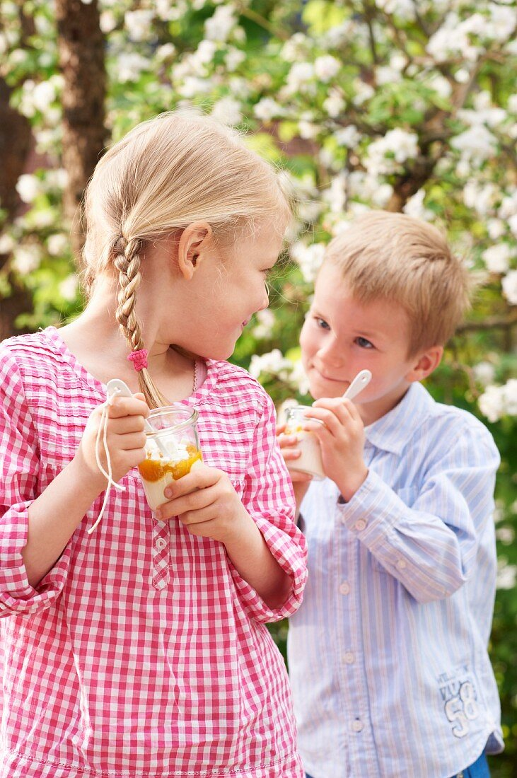 Children eating Eton Mess with apricots