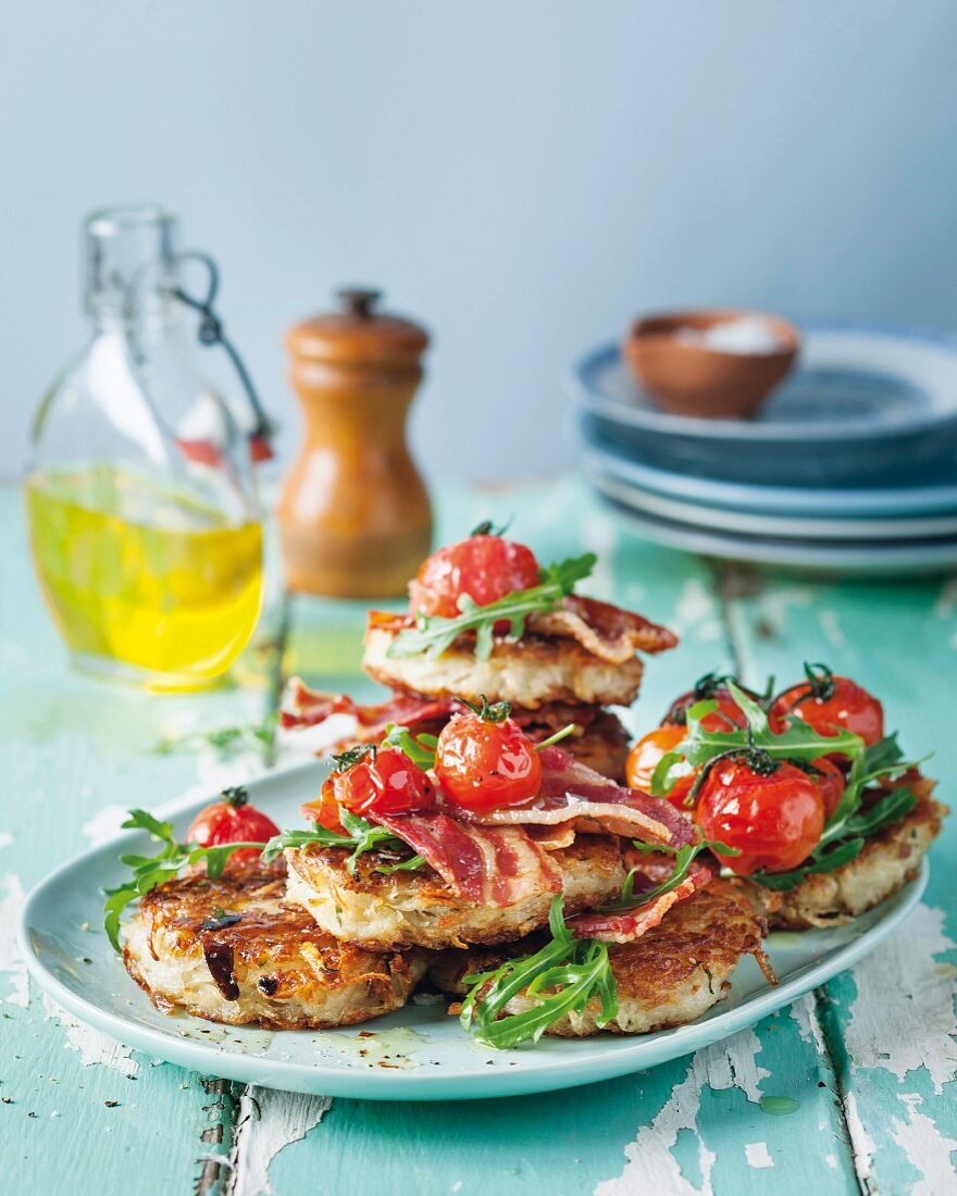 Potato fritters with bacon, tomatoes and rocket