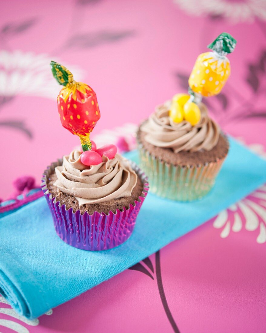 Chocolate cupcakes decorated with lollies and jelly beans