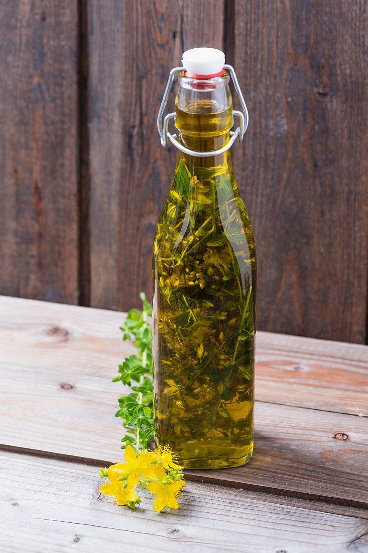 St. John's Wort oil in a flip-top bottle