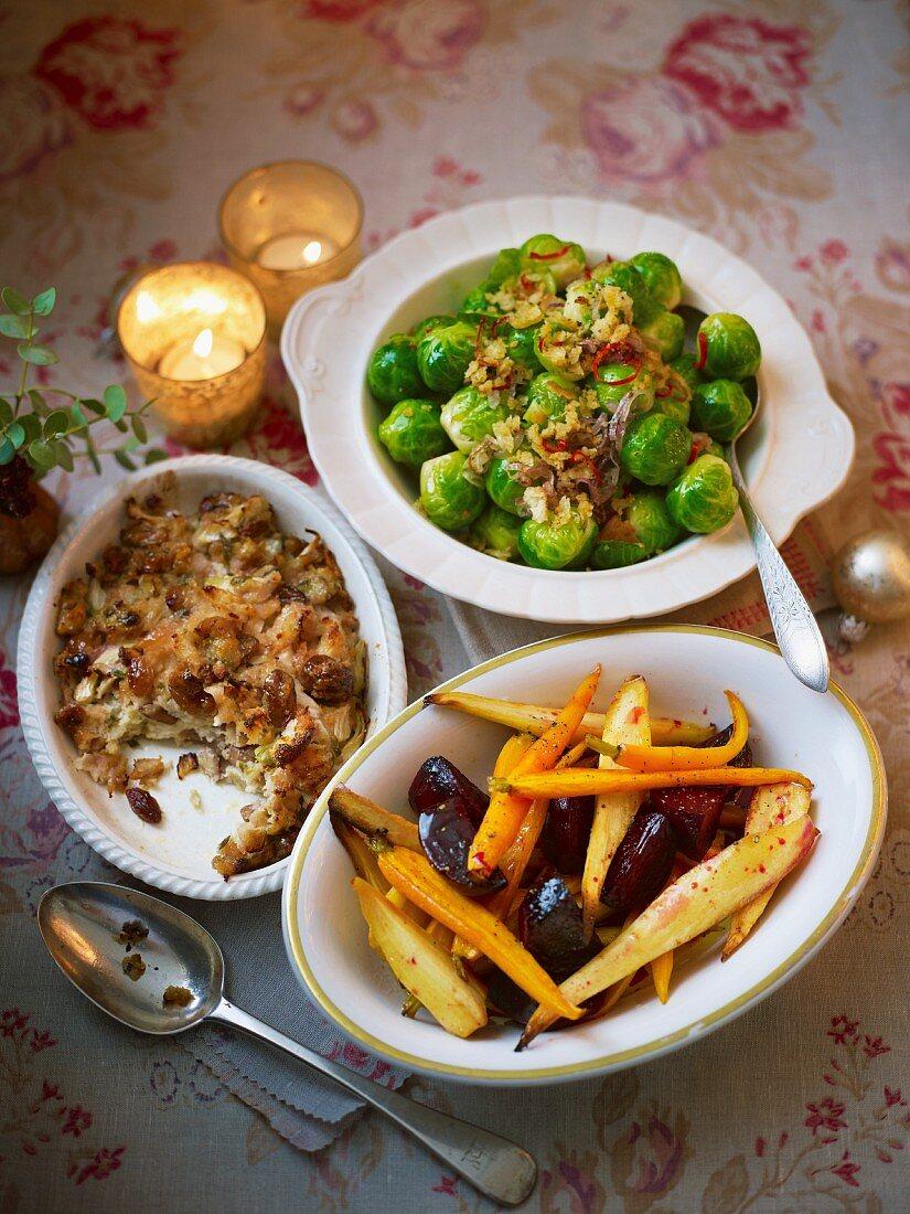 Christmas side dishes on an atmospheric Christmas table