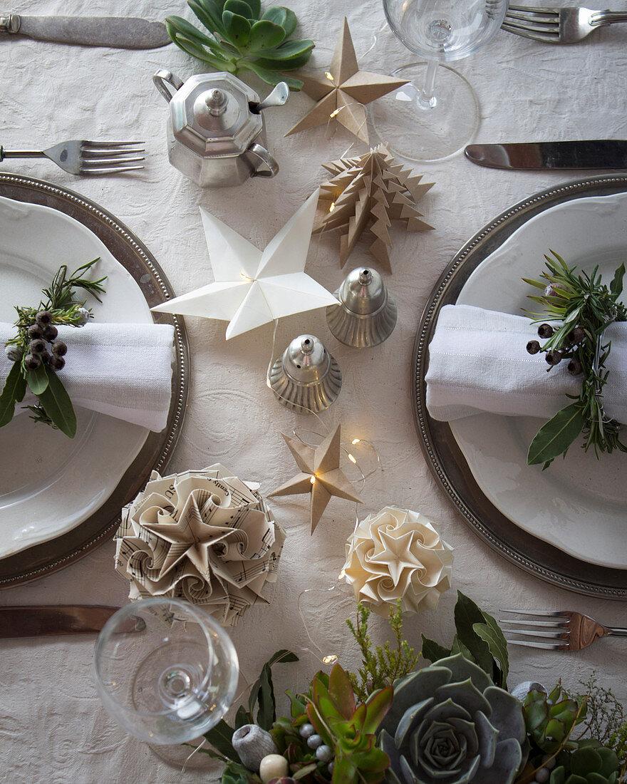 Handmade origami Christmas decorations on table