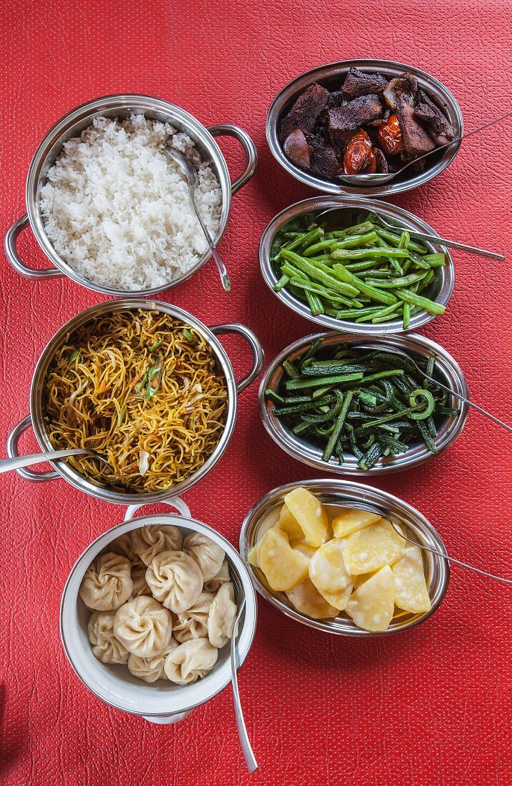 Rice, noodles and various Bhutanese side dishes (Asia)