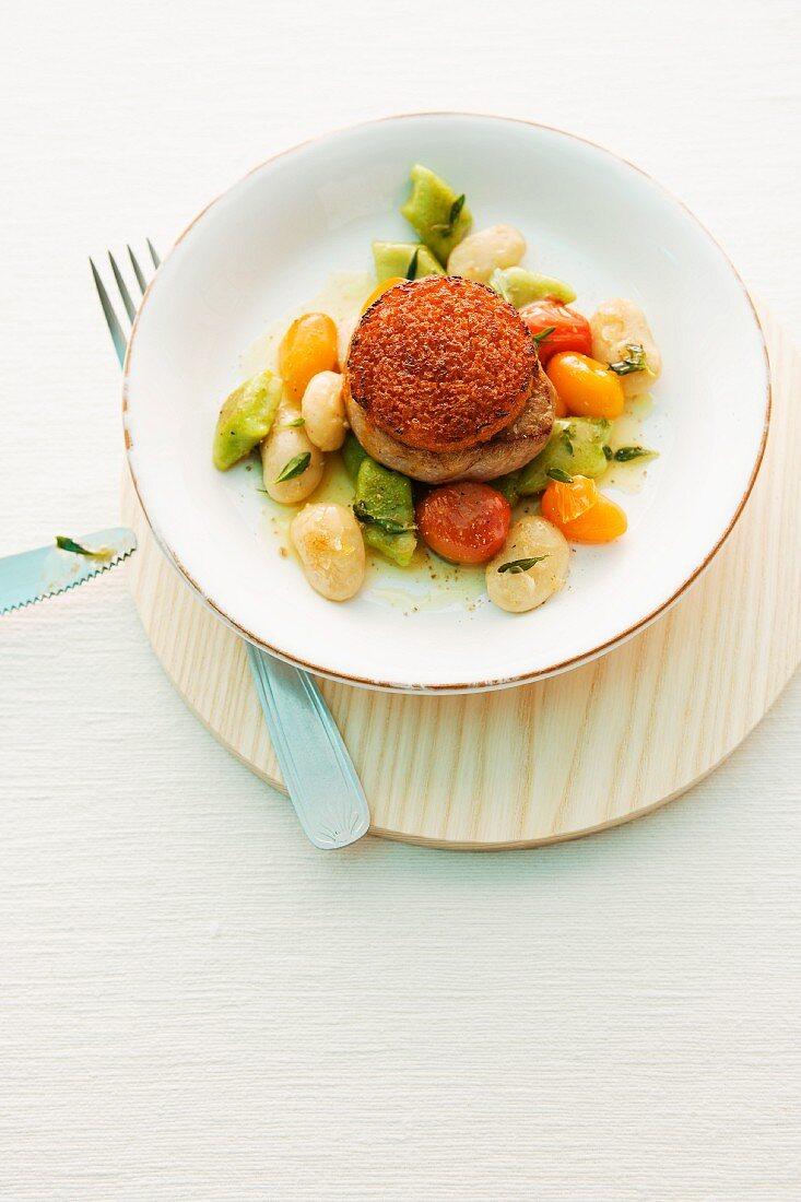 Pork medallion on gnocchi salad with a potato cake