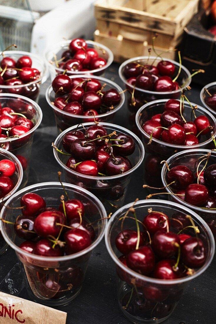 Organic cherries in plastic cups