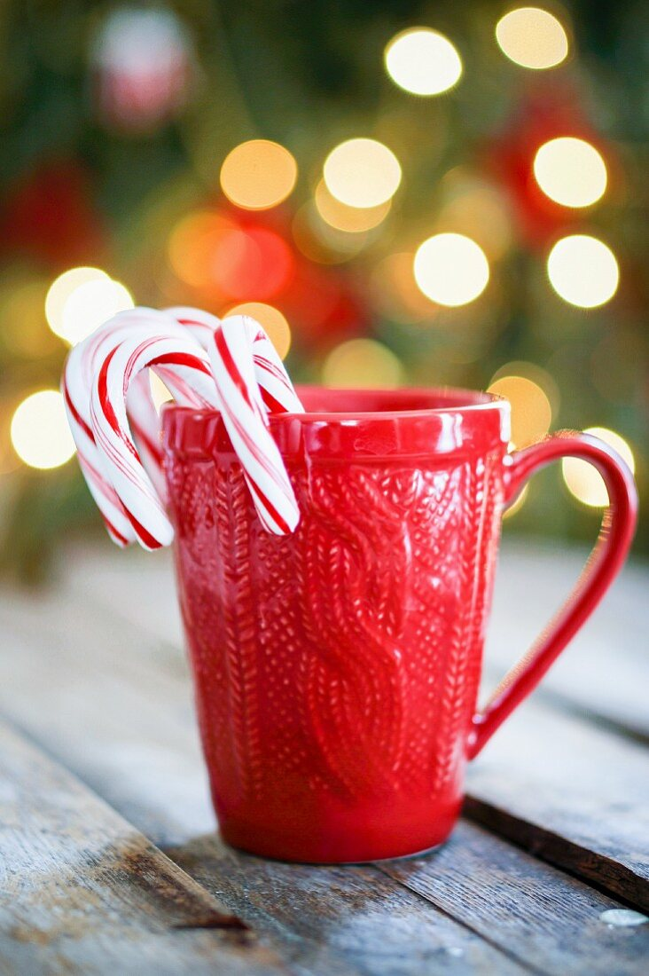 Candy canes in a red cup