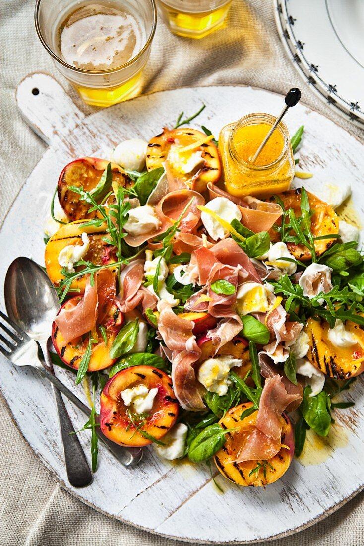 A salad with Prosciutto, grilled nectarines and bocconcini mozzarella