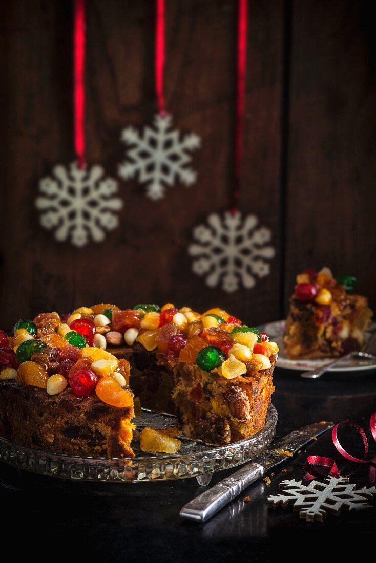 Glazed fruit Christmas cake with Christmas decorations