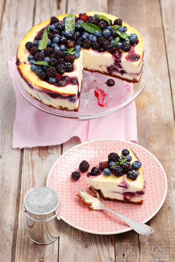 Blackberry and blueberry cheesecake, sliced
