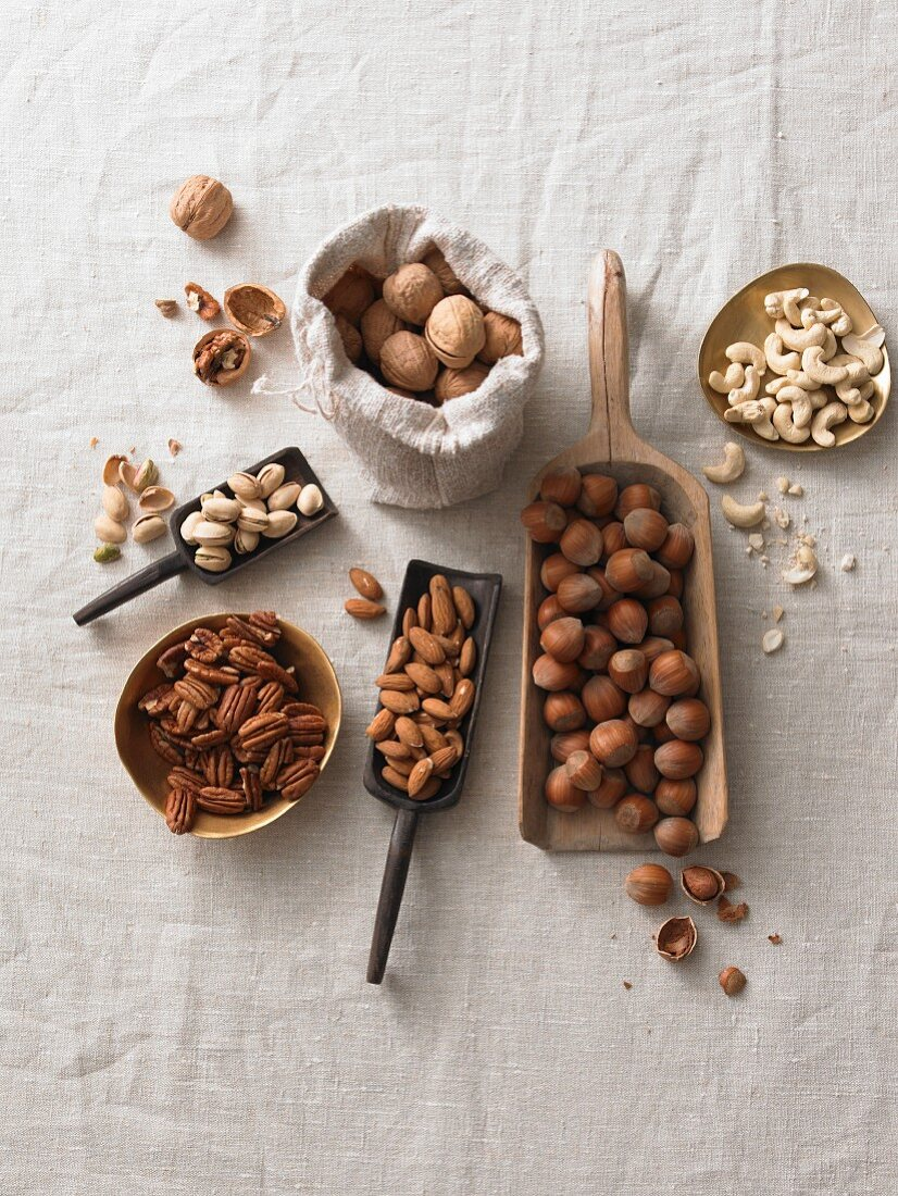 Various nuts on a white linen cloth