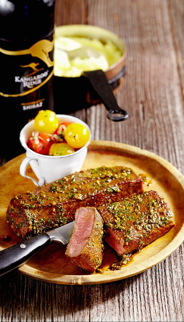 Lamb steaks with shiraz tomatoes