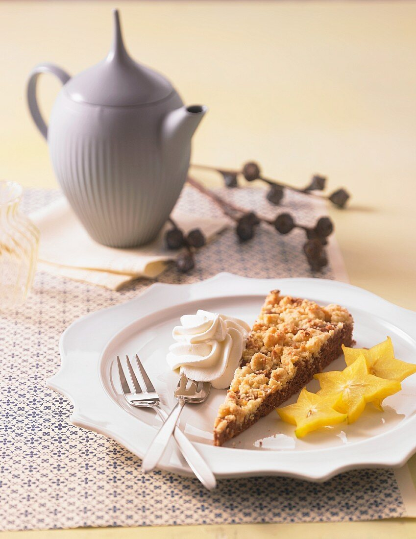 Spiced cake with marzipan crumbles, cream and star fruits