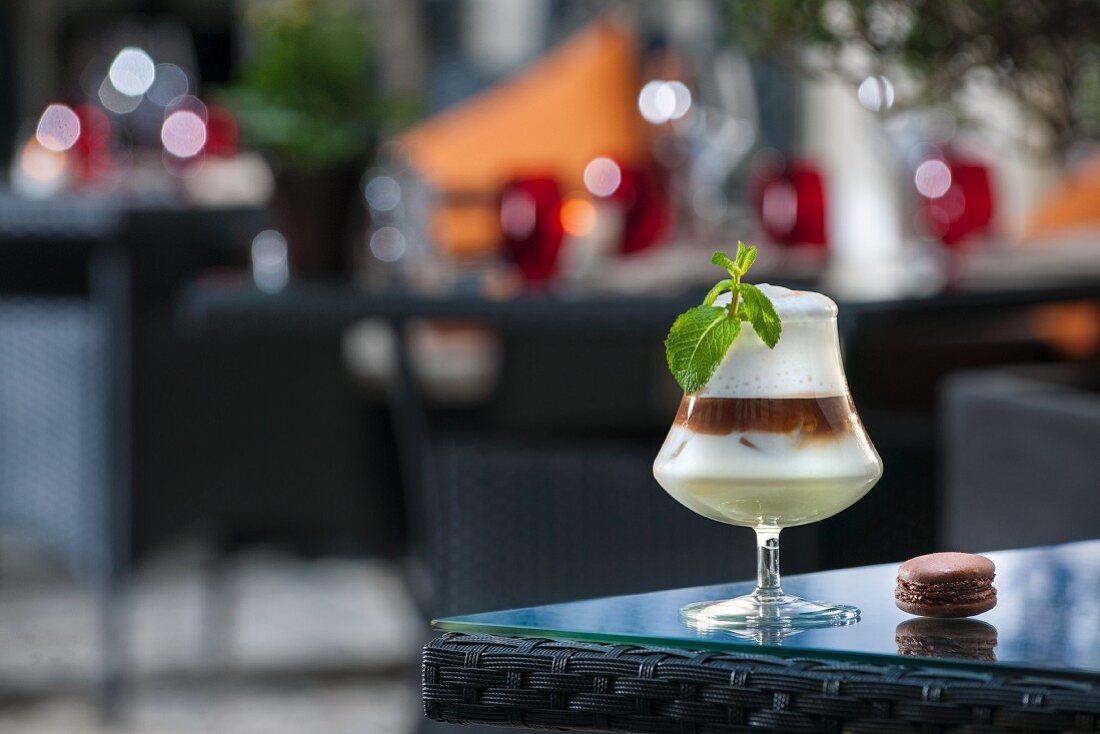 An Irish coffee cocktail on a patio table (Buddha-Bar Hotel, Paris)