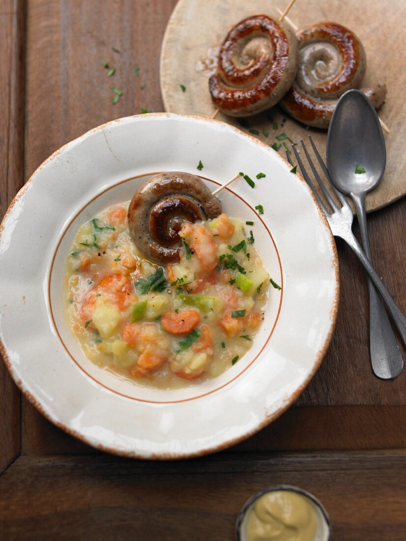 Carrot stew with spiral sausages