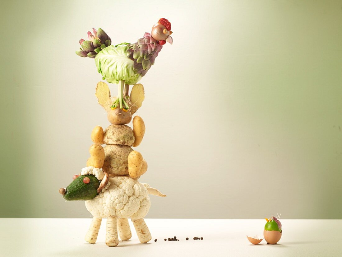 A stack of vegetable animals with an Easter egg