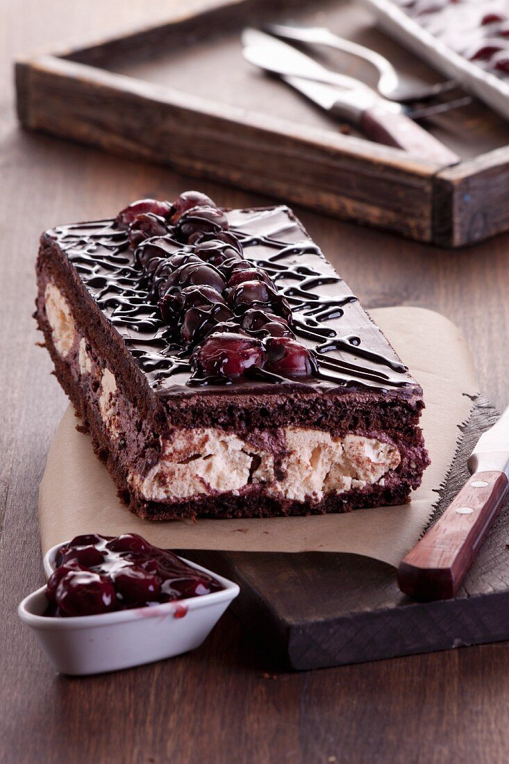 Chocolate sponge cake with cherries and meringue