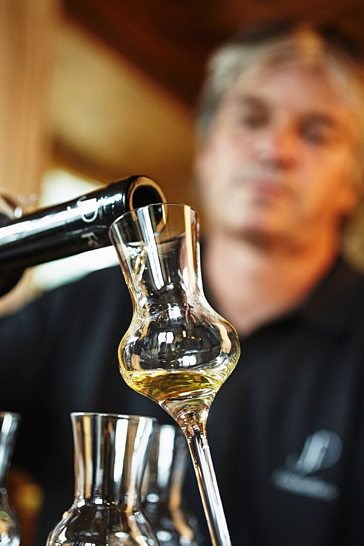 Schnapps being poured into a glass