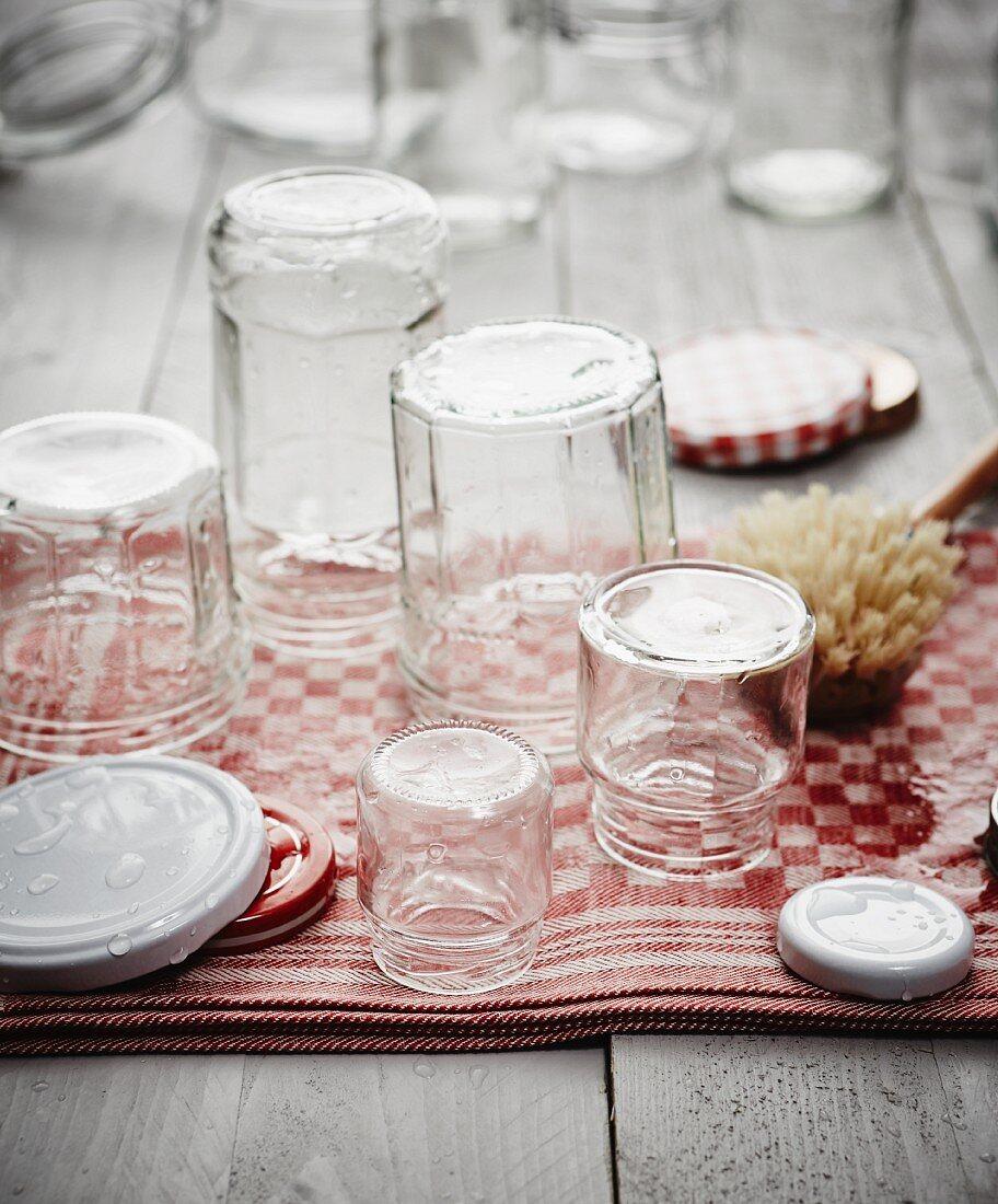 Sterilised jam jars on a tea towel