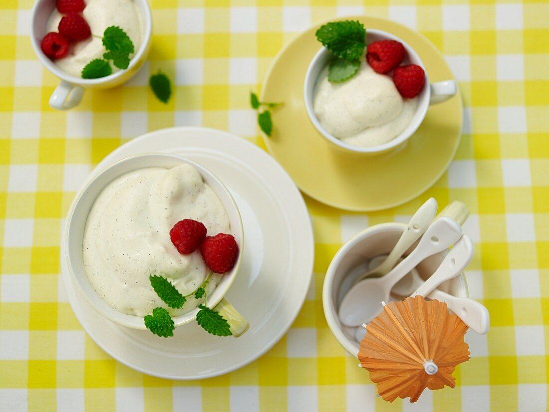 Vanilla mousse with raspberries and lemon balm