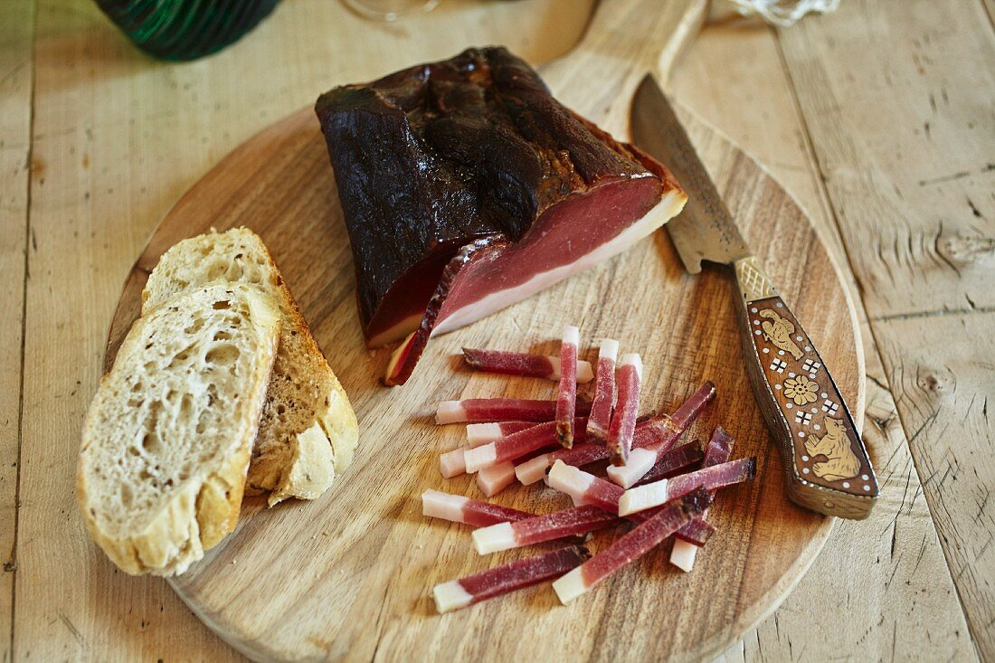 Tyrolean bacon and a knife with a wooden handle