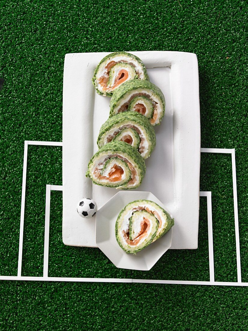Salmon rolls with spinach and cream cheese for a football themed party