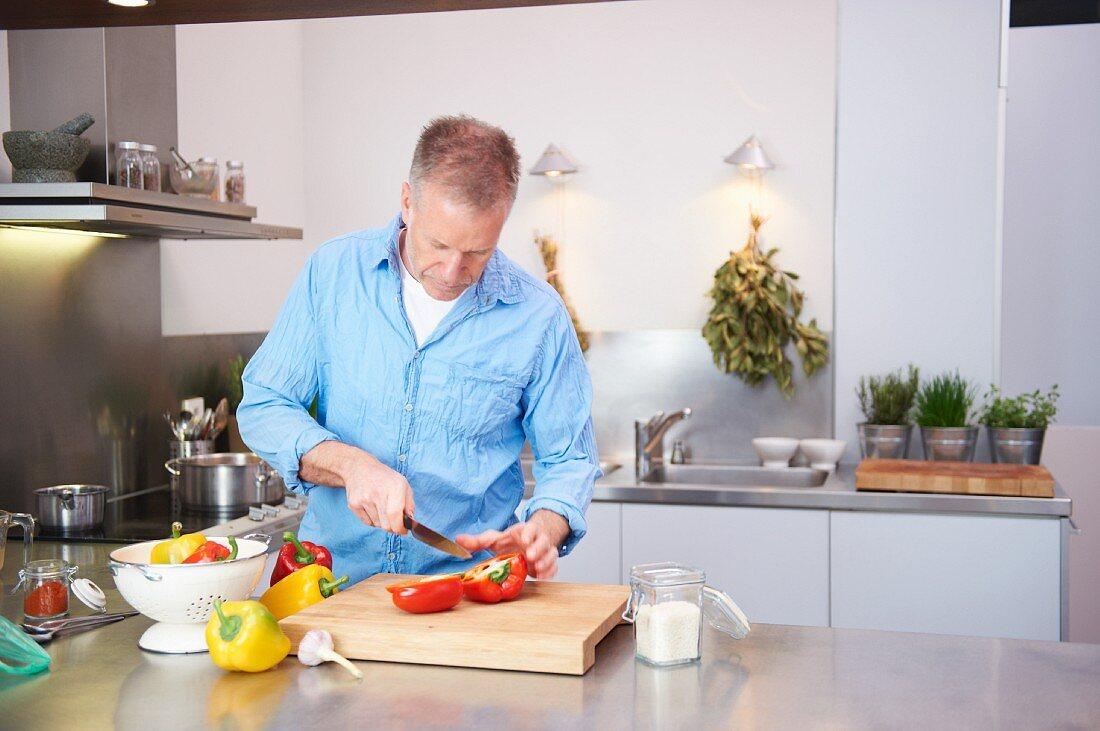 A man chopping a pepper