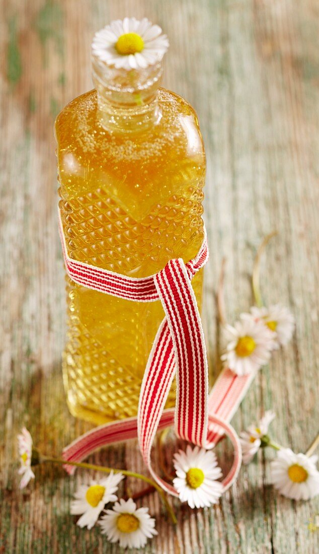 A bottle of daisy syrup