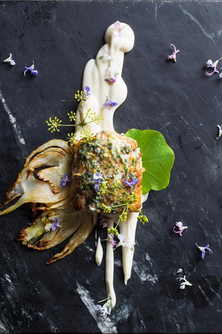 Hake with rosemary and citrus butter, vanilla and cauliflower purée, watercress and edible flowers