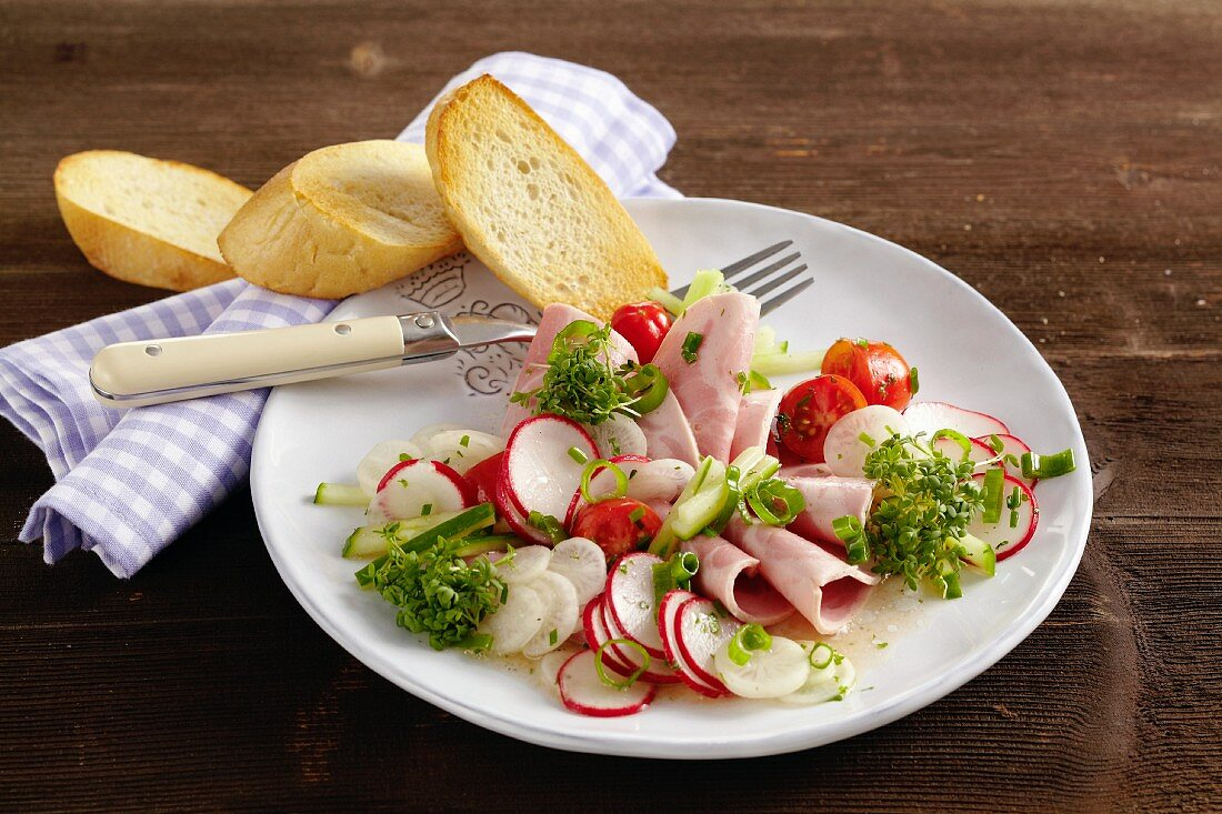Sausage salad with icicles and radishes