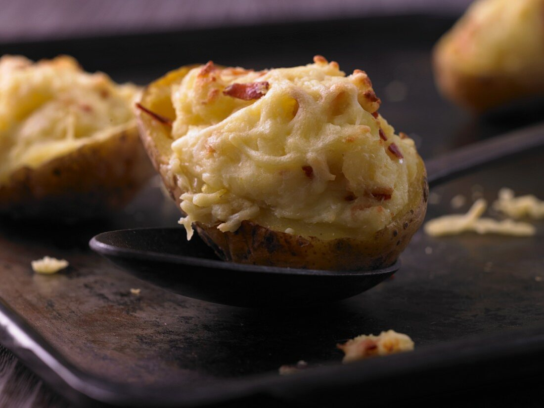 Oven baked potatoes topped with cheese