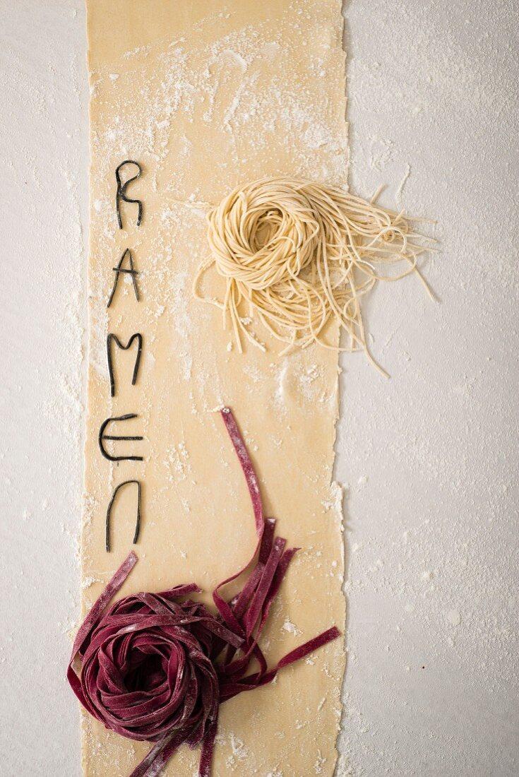An arrangement of fresh noodles and the word Ramen