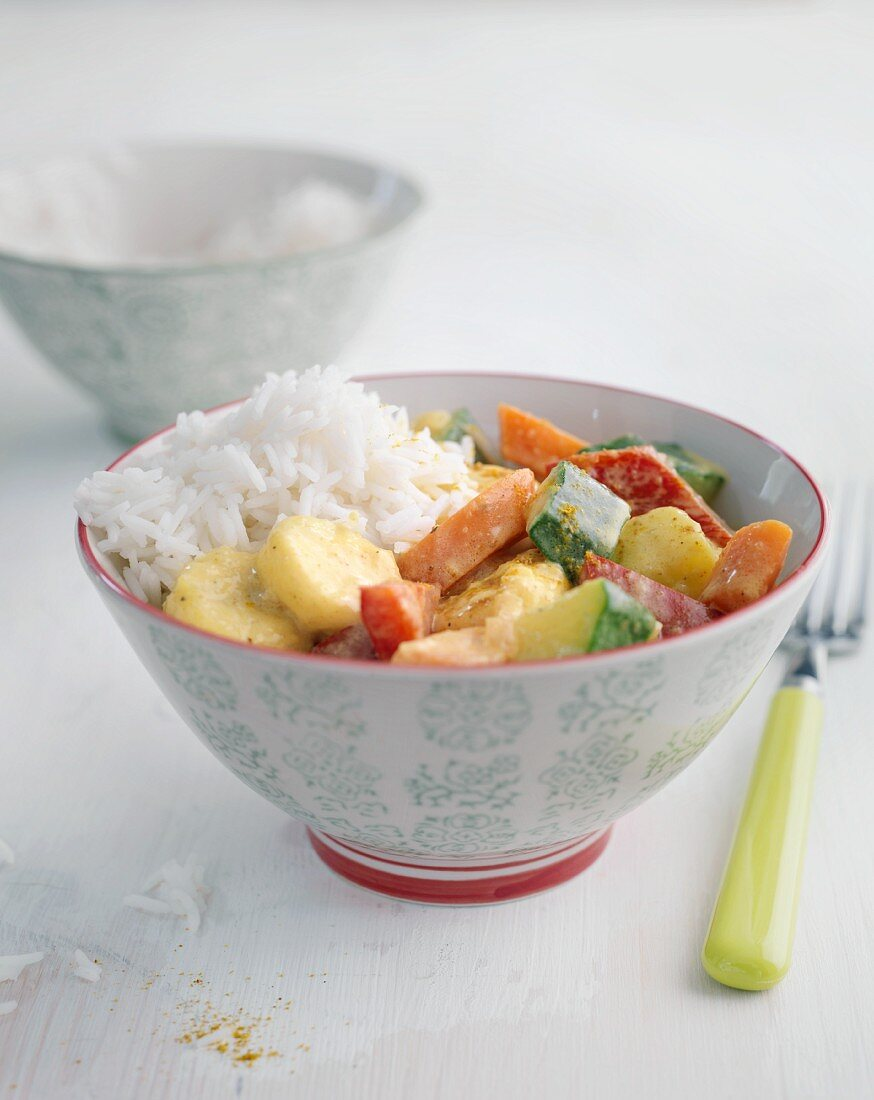 Colourful vegetable and banana curry with rice