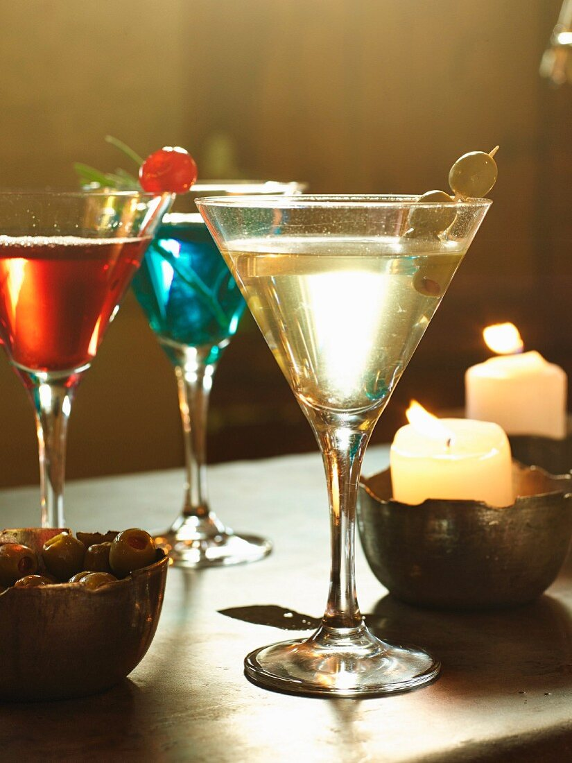 Christmas cocktails and burning candles