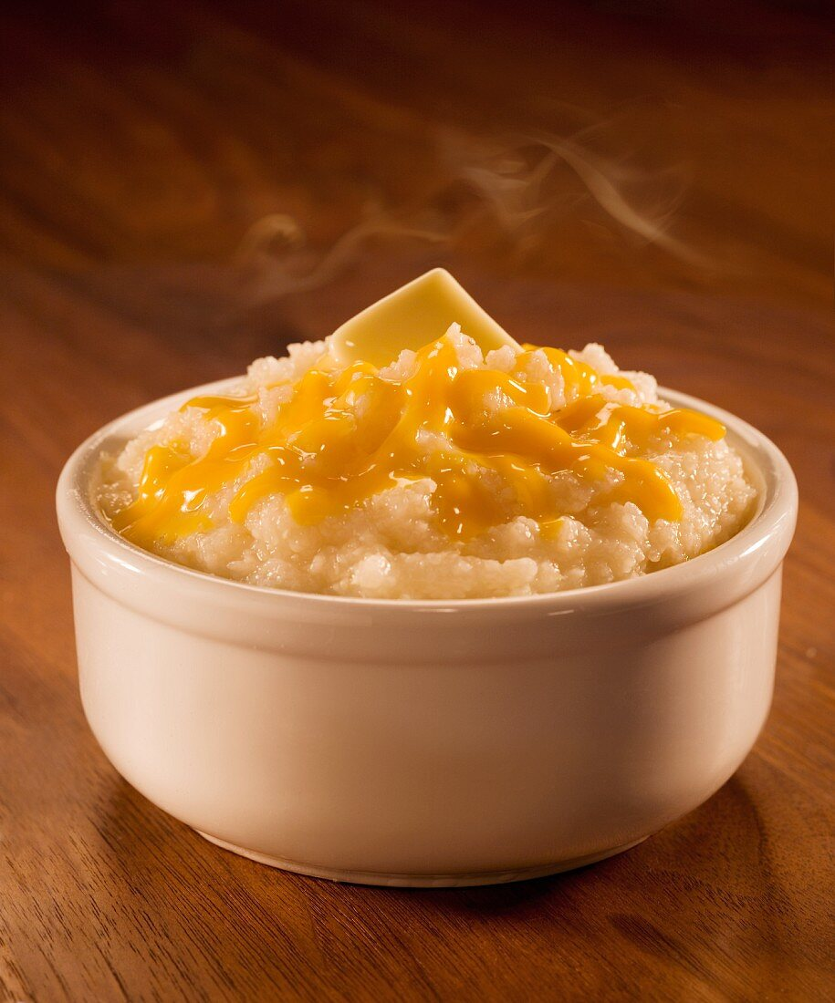 Hot grits with cheese and butter (USA)