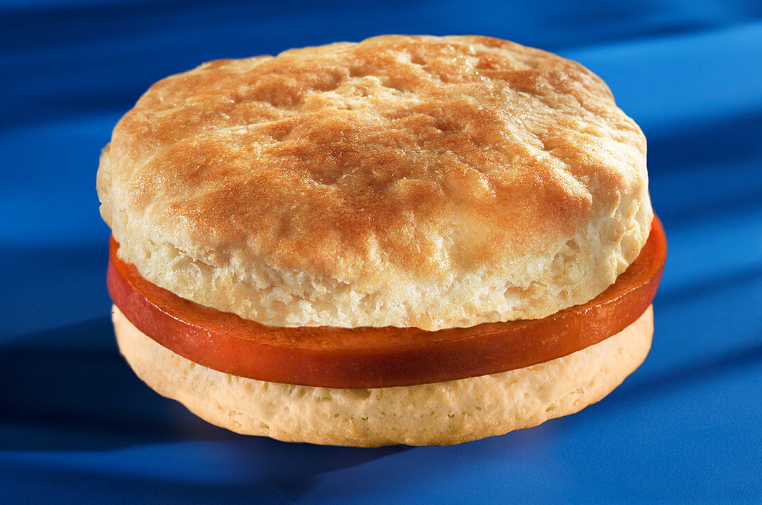 A slice of ham on an American biscuit