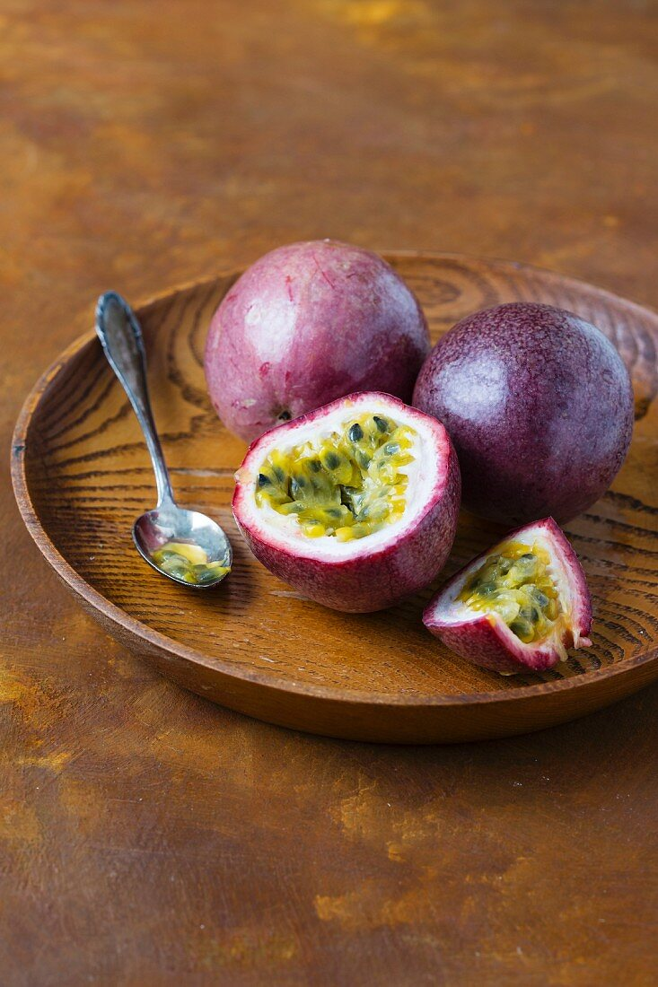 Passion fruits on a wooden dish