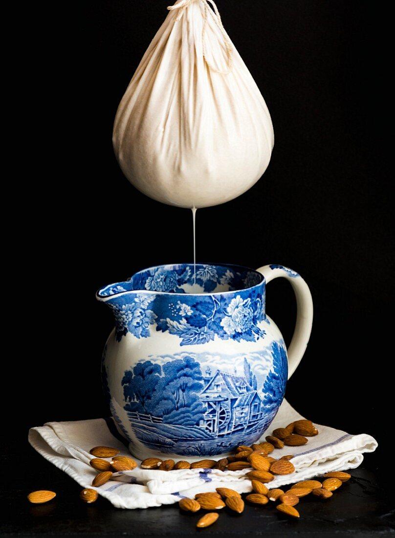 Almond milk being sieved