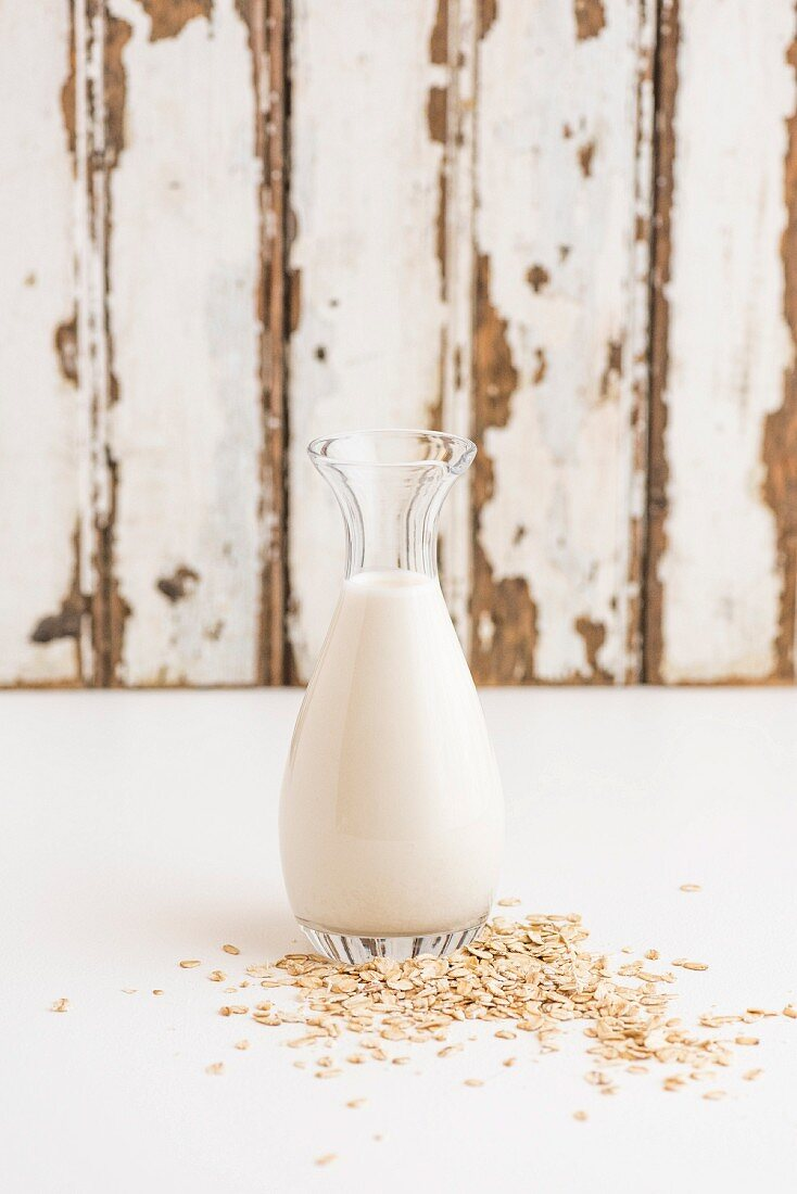 Oats and a bottle of oat milk