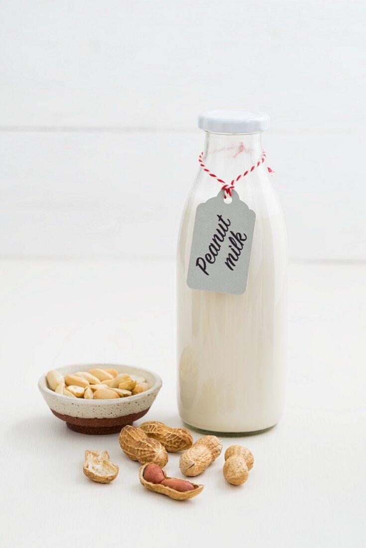 Peanut milk in a glass bottle