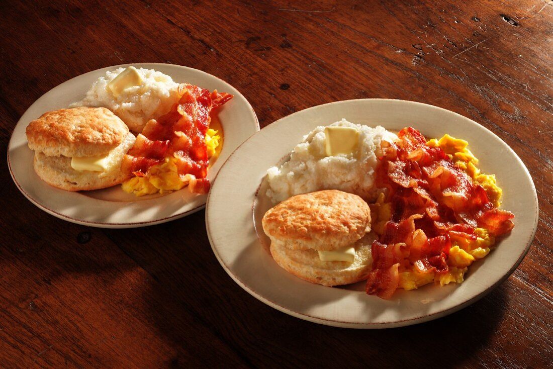Scrambled eggs with bacon, American biscuits and grits