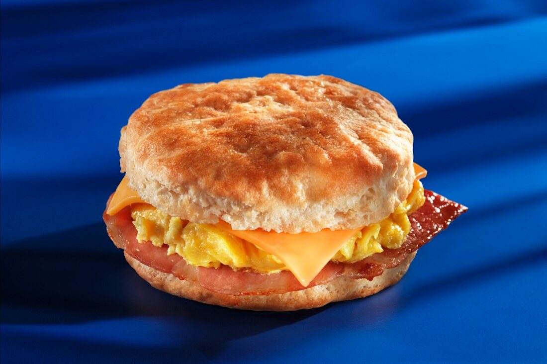 An American biscuit with ham, scrambled egg and cheese